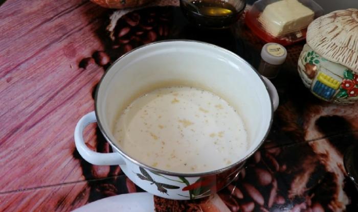 Залить пшено молоком с водой
